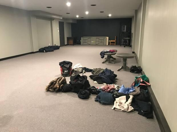 A small donation pile has started in the hotel's basement for anyone needing fresh clothes after the flood.