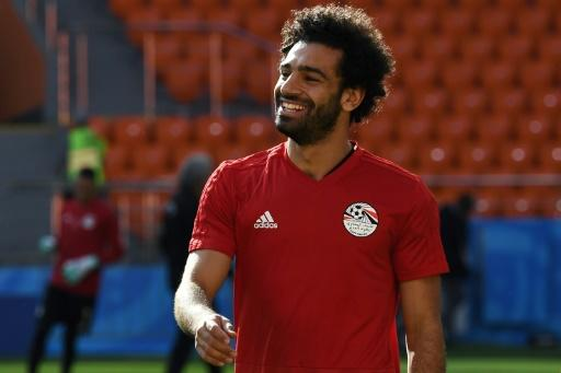 All smiles: Mohamed Salah has recovered from a shoulder injury in time to face Uruguay on Friday
