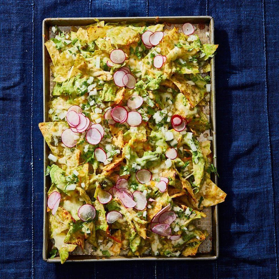"""<p>Yes, you can make nachos in the air fryer! Just cook until the cheese is melted and the toppings are warmed through.</p><p><em><a href=""""https://www.goodhousekeeping.com/food-recipes/a29738674/chicken-suizas-nachos-recipe/"""" rel=""""nofollow noopener"""" target=""""_blank"""" data-ylk=""""slk:Get the recipe for Chicken Suizas Nachos »"""" class=""""link rapid-noclick-resp"""">Get the recipe for Chicken Suizas Nachos »</a></em></p>"""