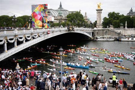 Hundreds of canoe and kayakers paddle under the Pont Alexandre III bridge on the River Seine in Paris, France, June 23, 2017 as Paris is transformed into a giant Olympic park to celebrate International Olympic Days with a variety of sporting events for the public across the city during two days as the city bids to host the 2024 Olympic and Paralympic Games.  REUTERS/Charles Platiau