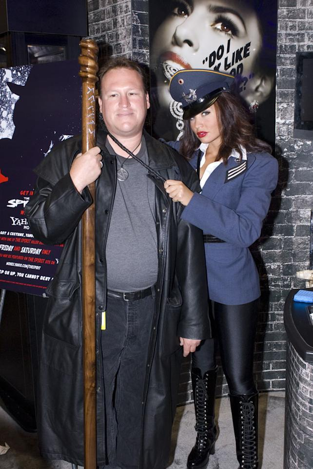"A costumed Comic-Con attendee poses with one of the ""Killer Beauties"" from Lionsgate's <a href=""http://movies.yahoo.com/movie/1809838857/info"">The Spirit</a>."