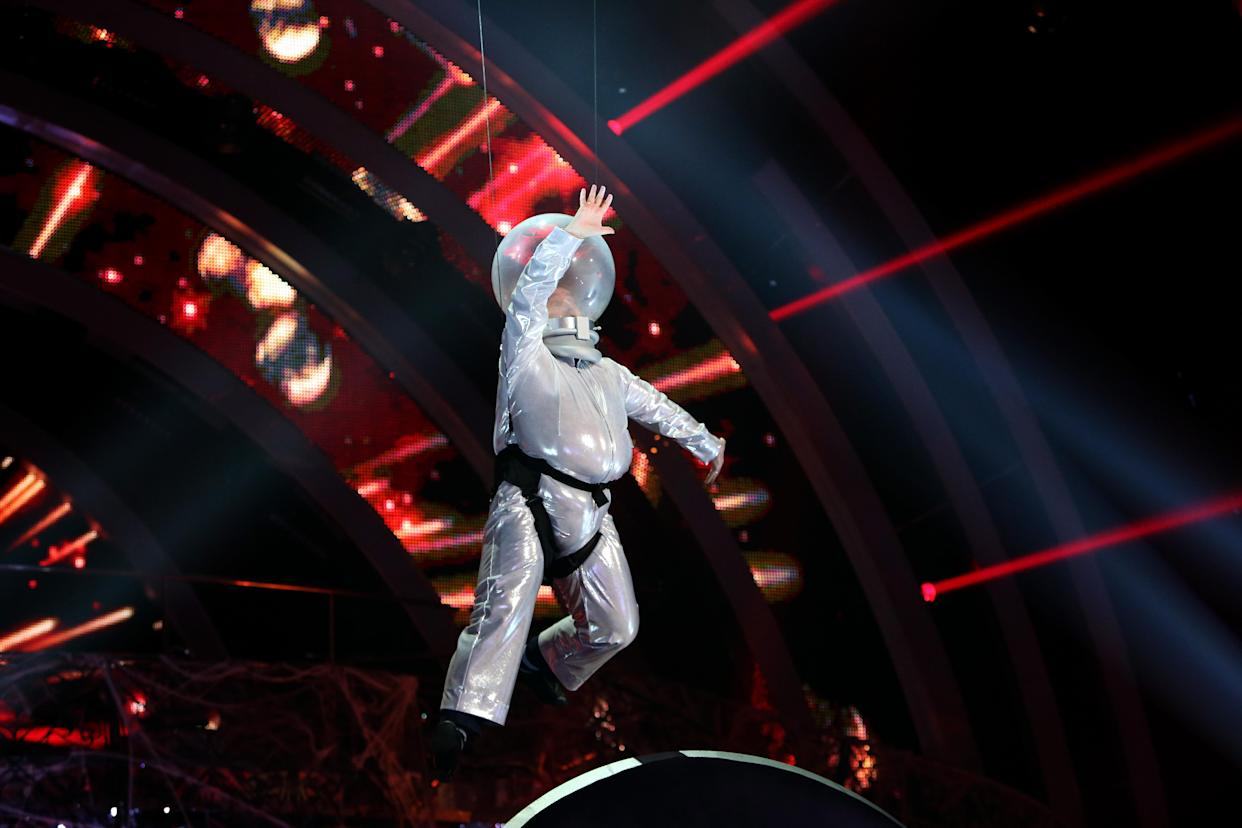Embargoed to 0001 Saturday November 2. Strictly Come Dancing contestant Mark Benton flies through the air in a spaceman costume during a rehearsal for his Halloween dance routine at Elstree Studios in Borehamwood, Hertfordshire.