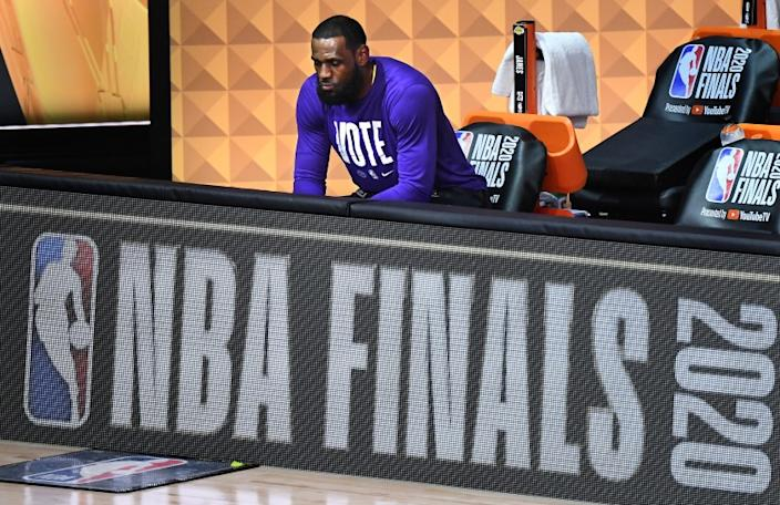 ORLANDO, FLORIDA OCTOBER 9, 2020-Lakers LeBron James sits alone before Game 5 of the NBA Finals