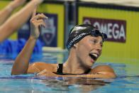 Hali Flickinger reacts after the women's 200 butterfly during wave 2 of the U.S. Olympic Swim Trials on Thursday, June 17, 2021, in Omaha, Neb. (AP Photo/Charlie Neibergall)
