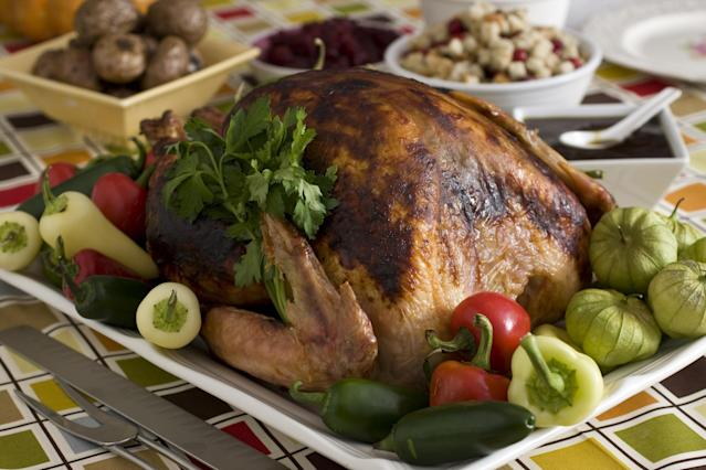 """This photo taken Nov. 8, 2009 shows a roasted turkey in apricot-chili glaze. With the roots of Americans originating in over 125 different countries it is only natural the flavors and traditions of other cultures should become part of our Thanksgiving feasts. Marcela Valladolid, author of """"Fresh Mexico"""", brings her Mexican roots into this adapted recipe for roasted turkey in apricot-chili glaze. (AP Photo/Larry Crowe)"""