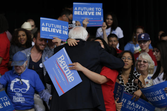 Bernie Sanders gets a hug from a supporter at a Nevada caucus watch party in Henderson, Nev., on Saturday. (Jae C. Hong/AP)