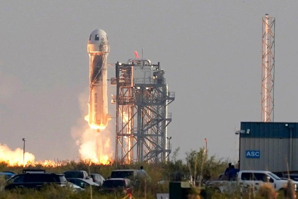 Blue Origin's New Shepard rocket launches carrying passengers Jeff Bezos, founder of Amazon and space tourism company Blue Origin, his brother Mark Bezos, Oliver Daemen and Wally Funk, from its spaceport near Van Horn, Texas (AP)