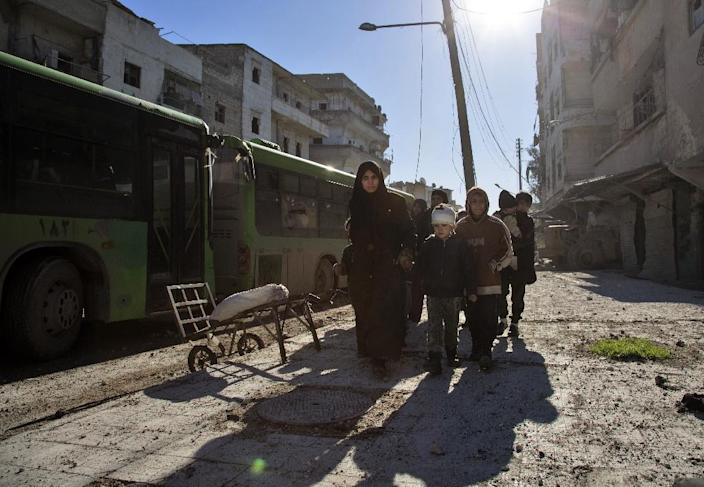 Syrians gather during an evacuation operation of rebel fighters and civilians from rebel-held neighbourhoods of Aleppo (AFP Photo/Karam Al-Masri)