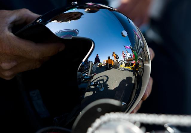 Other competitors are reflect in the visor of Italy's Alessandro Zanardi as he prepares to take part in the men's individual H4 time trial cycling final during the London 2012 Paralympic Games at Brands Hatch circuit, in Kent, southern England on September 5, 2012. AFP PHOTO / LEON NEALLEON NEAL/AFP/GettyImages