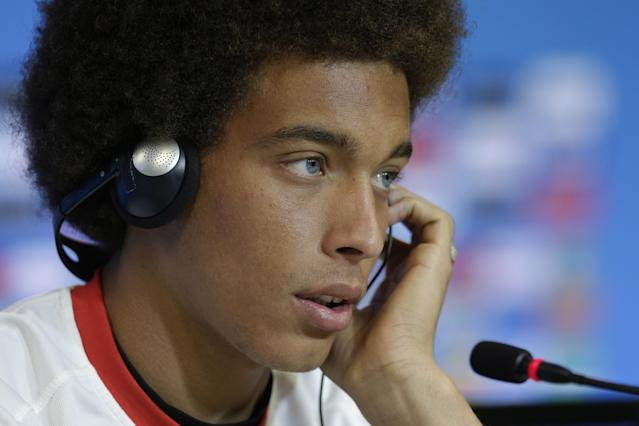 Belgium's Axel Witsel wears translation headphones during a press conference the day before the World Cup round of 16 soccer match between Belgium and USA at Arena Fonte Nova in Salvador, Brazil, Monday, June 30, 2014. (AP Photo/Julio Cortez)