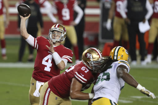 San Francisco 49ers quarterback Nick Mullens (4) passes against the Green Bay Packers during the first half of an NFL football game in Santa Clara, Calif., Thursday, Nov. 5, 2020. (AP Photo/Jed Jacobsohn)