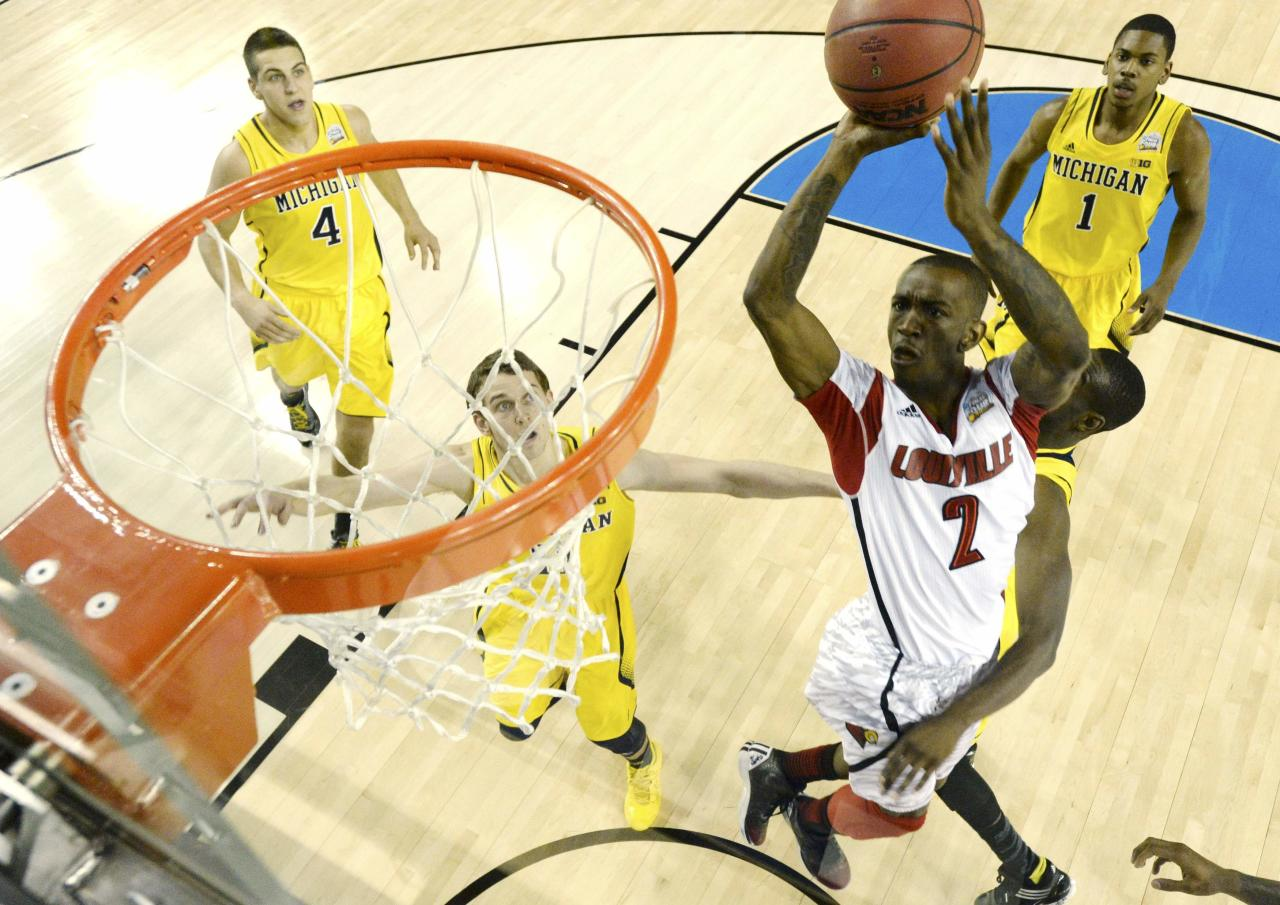 Louisville Cardinals guard Russ Smith (2) scores against the Michigan Wolverines in the first half of their NCAA men's Final Four championship basketball game in Atlanta, Georgia April 8, 2013.  