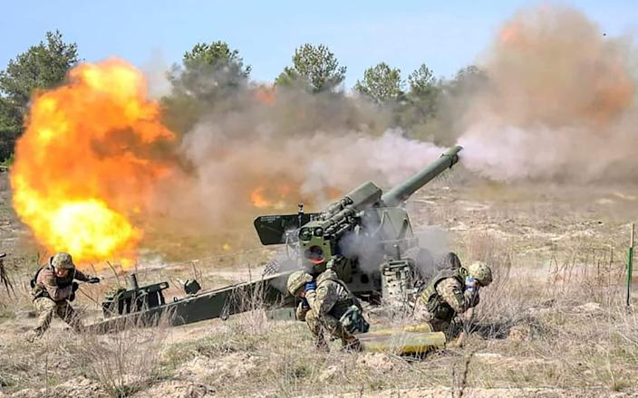 Ukrainian and Canadian servicemen do training exercises to get ready for large scale International military drills in Western Ukraine