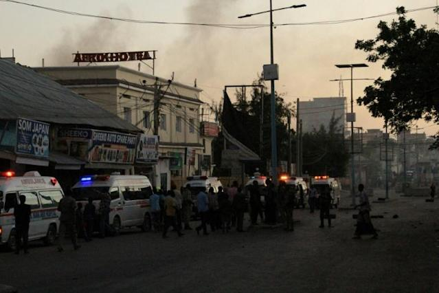 Ambulances line up to collect the woudned after armed men attacked a hotel in central Mogadishu following a car bombing at the entrance of the building in January 2021