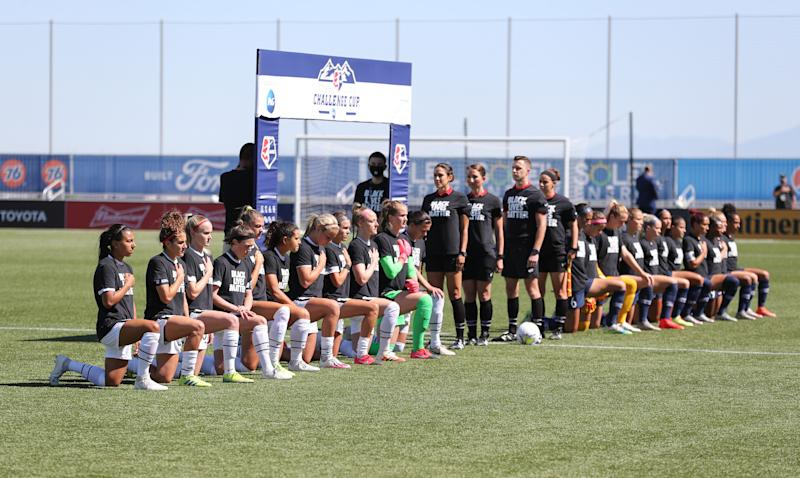 HERRIMAN, UT - JUNE 27: Portland Thorns FC Starting Eleven kneel in support of Black Lives Matter before a game between Portland Thorns FC and North Carolina Courage at Zions Bank Stadium on June 27, 2020 in Herriman, Utah. (Photo by Robert Gray/ISI Photos/Getty Images).