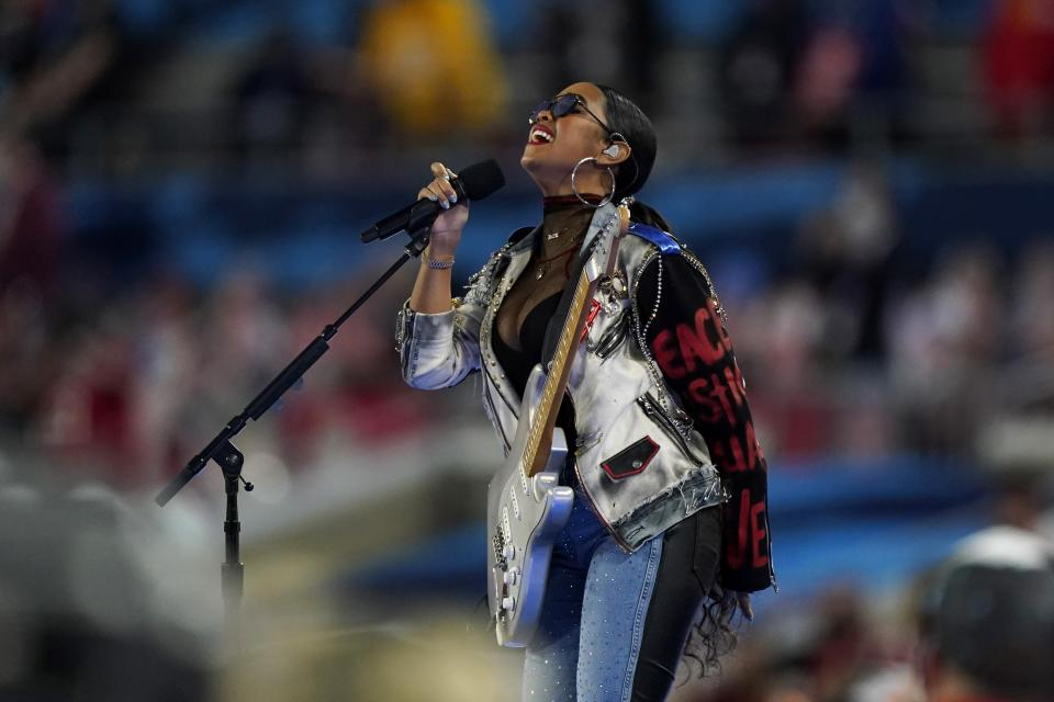 "H.E.R. performs ""America the Beautiful"" before the NFL Super Bowl 55 football game between the Kansas City Chiefs and Tampa Bay Buccaneers, Sunday, Feb. 7, 2021, in Tampa, Fla. (AP Photo/Gregory Bull)"