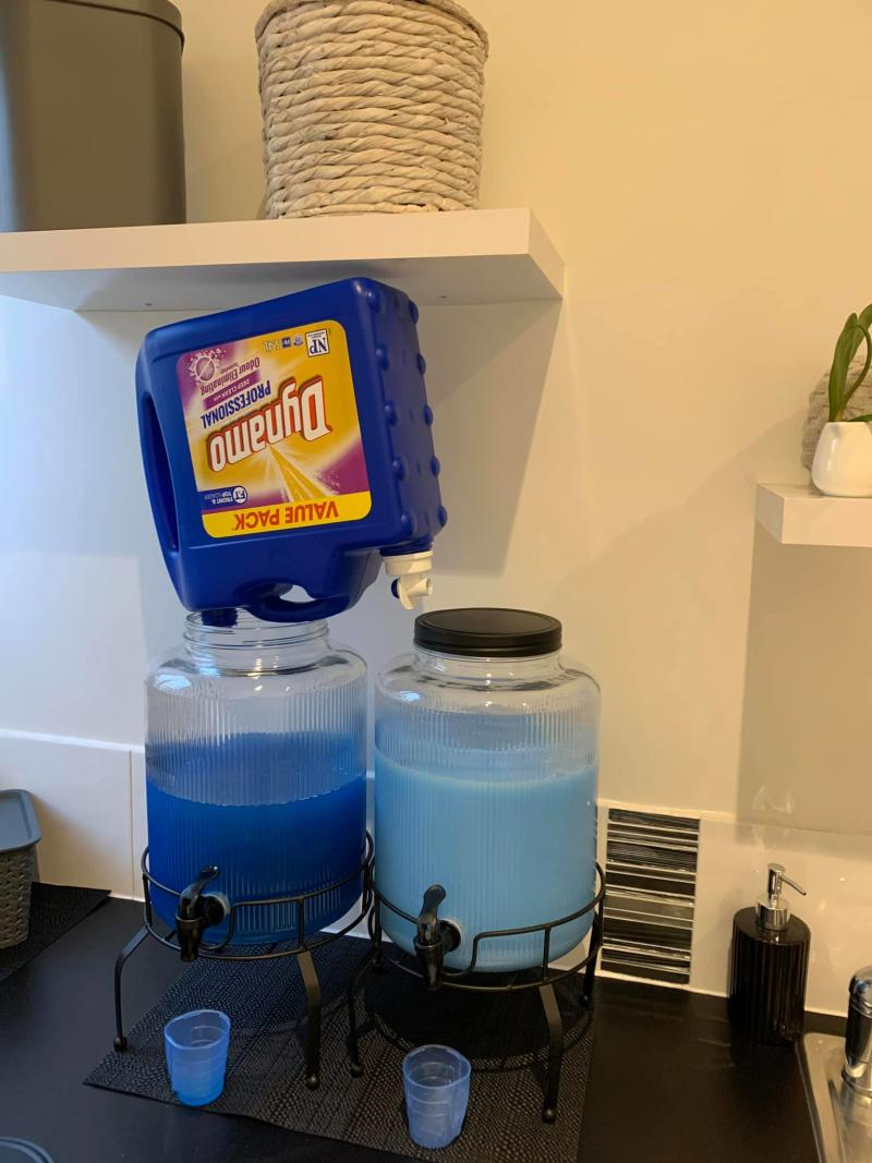 The mum-of-two shared her hack using Kmart drink dispensers to hold her detergent. Photo: Facebook