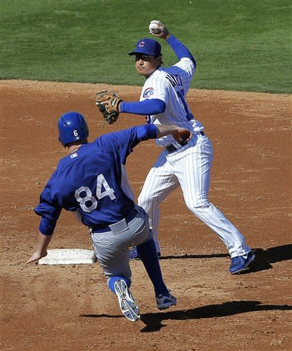 Los Angeles Dodgers' Rusty Ryal (84) is forced out by Chicago Cubs' Darwin Barney during the third inning of an exhibition spring training baseball game, Wednesday, Feb. 27, 2013, in Mesa, Ariz. (AP Photo/Matt York)