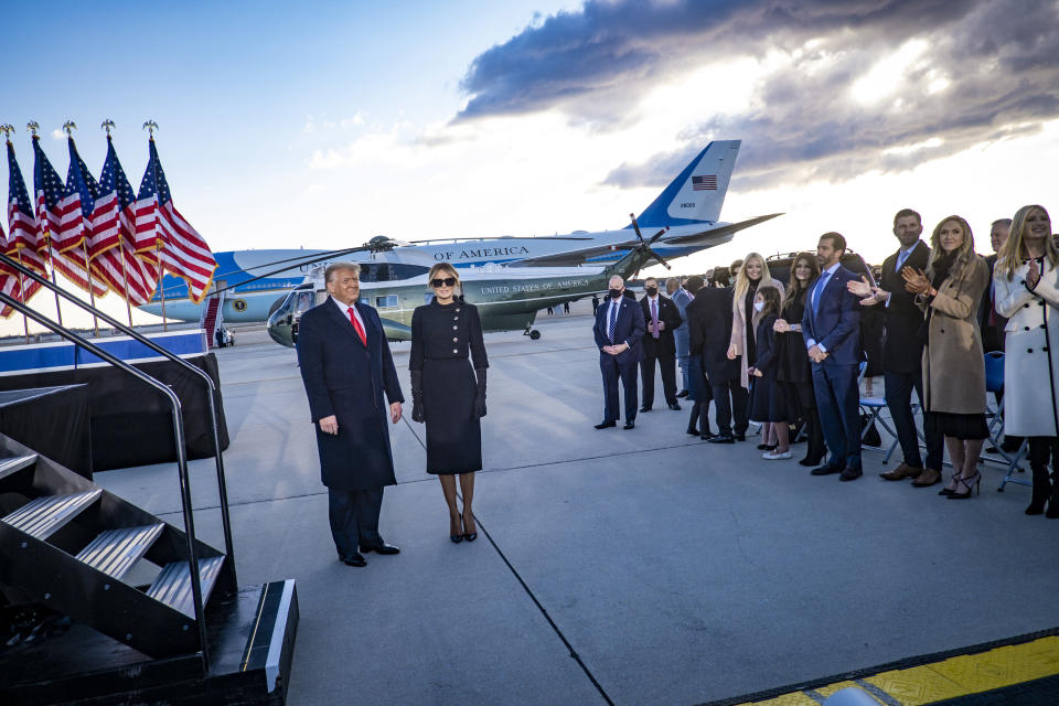 Then-President Donald Trump and first lady Melania Trump at Joint Base Andrews, Md., before boarding Air Force One for the last time in office, Jan. 20, 2021. (Pete Marovich/The New York Times)