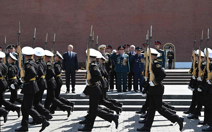 Putin attends the flower-laying ceremony at the Tomb of the Unknown Soldier - ALEXEY NIKOLSKY/Sputnik/AFP via Getty Images