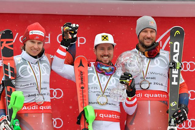 Alpine Skiing - FIS Alpine Skiing World Cup Finals 2018 - Are, Sweden - March 18, 2018. Henrik Kristoffersen of Norway, second placed, winner Marcel Hirscher of Austria, and Aksel Lund Svindal of Norway, third placed, pose with the World Cup overall trophy,. TT News Agency/Anders Wiklund/ via REUTERS ATTENTION EDITORS - THIS IMAGE WAS PROVIDED BY A THIRD PARTY. SWEDEN OUT. NO COMMERCIAL OR EDITORIAL SALES IN SWEDEN