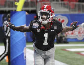 Georgia wide receiver George Pickens reacts to his touchdown against Cincinnati in the first half in the NCAA college football Peach Bowl game on Friday, Jan. 1, 2021, in Atlanta. (Curtis Compton/Atlanta Journal-Constitution via AP)