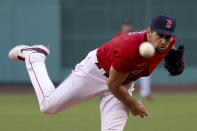 Boston Red Sox starting pitcher Nathan Eovaldi watches a throw to an Oakland Athletics batter during the first inning of a baseball game Tuesday, May 11, 2021, in Boston. (AP Photo/Mary Schwalm)