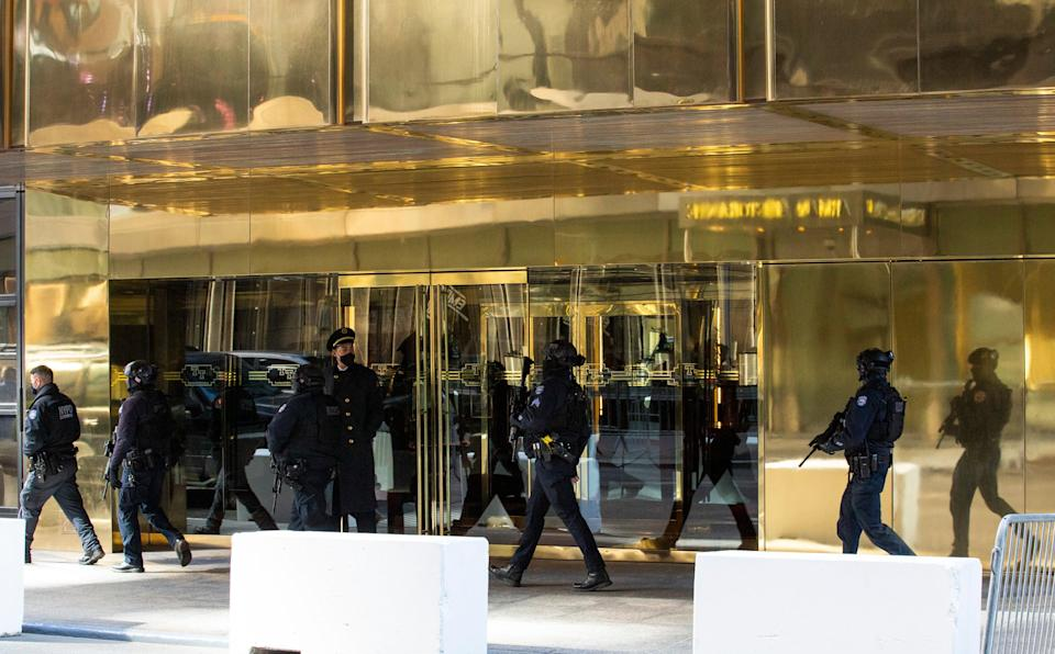 <p>New York Police Department officers patrol outside Trump Tower on March 7, 2021 in New York. - Former US President Donald Trump is set to visit New York for first time since leaving White House</p> (Photo by KENA BETANCUR/AFP via Getty Images)
