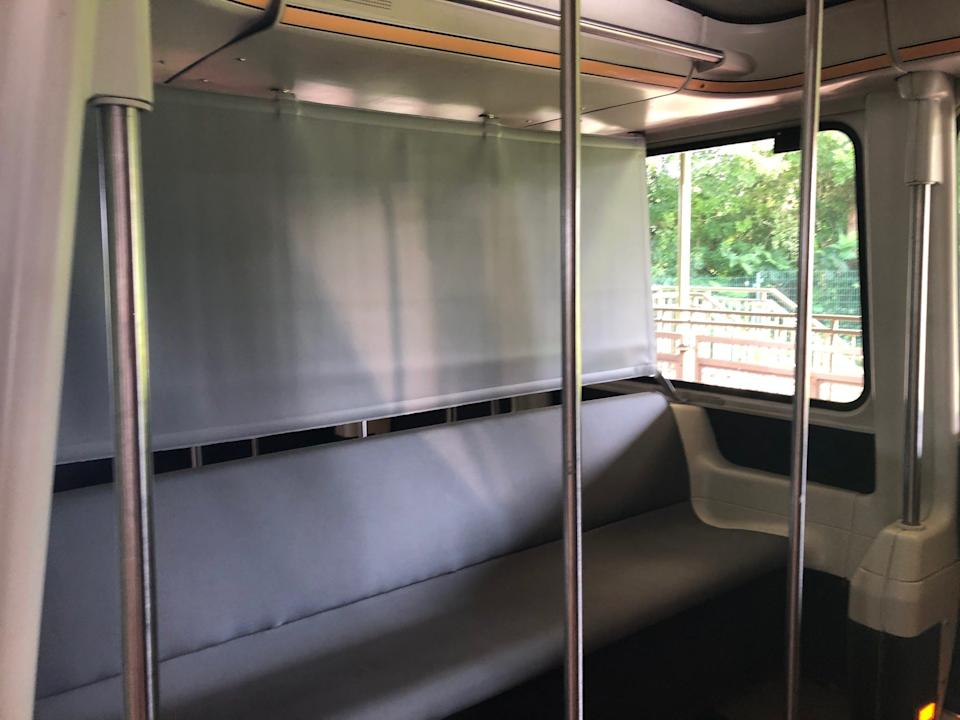 Disney's monorail cabins, which are normally standing-room only, have been divided up using vinyl barriers, and only one or two families were allowedin each.