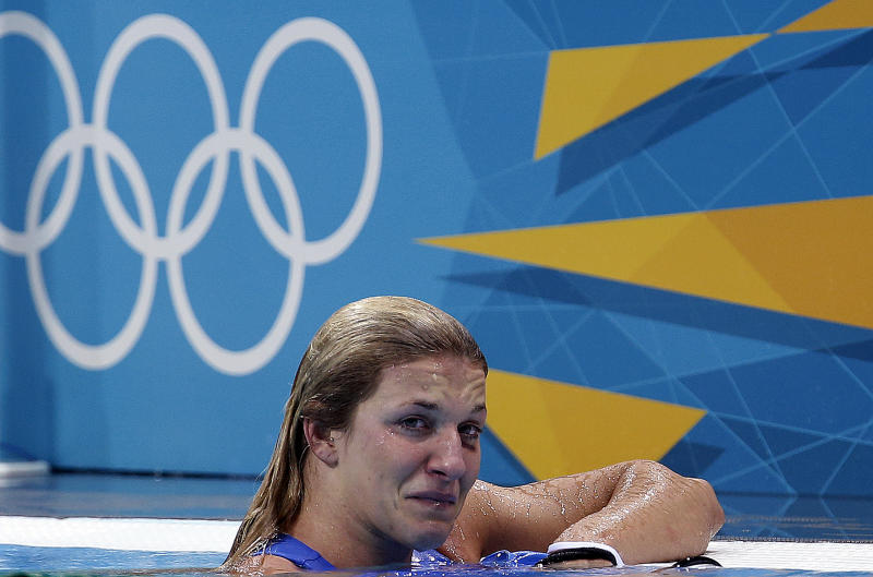 Teresa Frassinetti of Italy reacts after a 9-6 lost to the United States in a women's water polo quarterfinal match at the 2012 Summer Olympics, Sunday, Aug. 5, 2012, in London. (AP Photo/Julio Cortez)