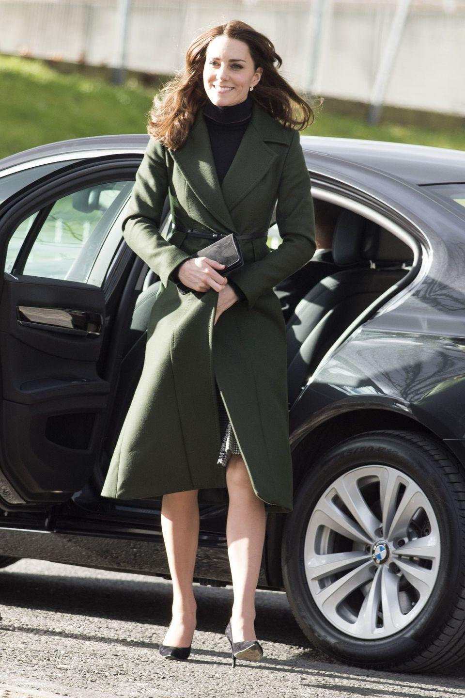 <p>As Middleton stepped out to visit various community projects in Edinburgh, she paired her black turtleneck with a deep green coat, cinched at the waist with a skinny belt.</p>