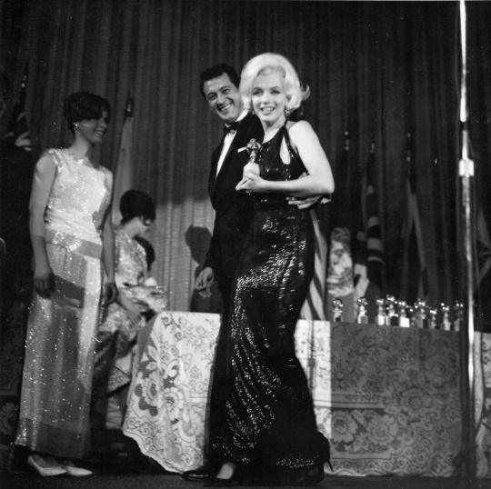 <p>The often imitated, but never equaled, Monroe received her last award in 1962 in a slinky, black sequin gown that no doubt turned heads at the ceremony and— rumor has it — sparked a romance with her presenter, Glenn Ford. (Photo: Getty Images) </p>