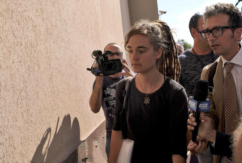 Sea-Watch3 German captain Carola Rackete is accompanied by her lawyer Leonardo Marino, right, as she arrives for questioning in court in the southern Sicilian town of Agrigento, Italy, Thursday, July 18, 2019. Rackete, who forced a government block docking at an Italian port after rescuing migrants, faces questioning by Italian prosecutors over allegedly aiding illegal immigration. (Pasquale Claudio Montana Lampo/ANSA via AP)