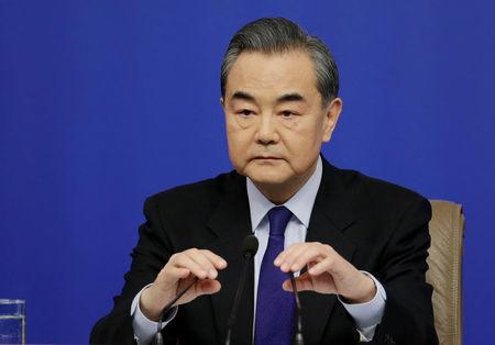 China's Foreign Minister Wang Yi attends a news conference during the ongoing NPC in central Beijing