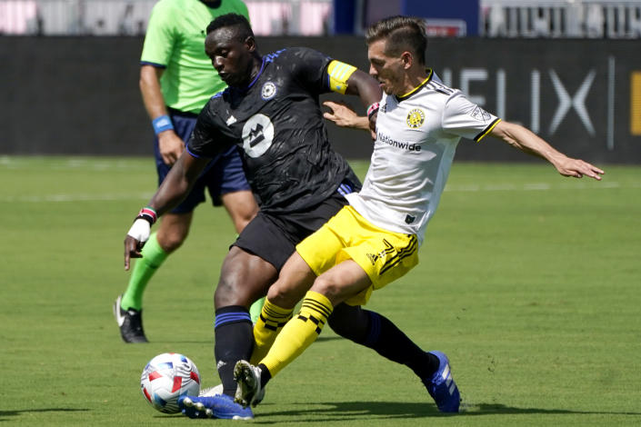 CF Montréal midfielder Victor Wanyama, left, and Columbus Crew forward Pedro Santos, right, go for the ball during the first half of an MLS soccer match, Saturday, May 1, 2021, in Fort Lauderdale, Fla. (AP Photo/Lynne Sladky)