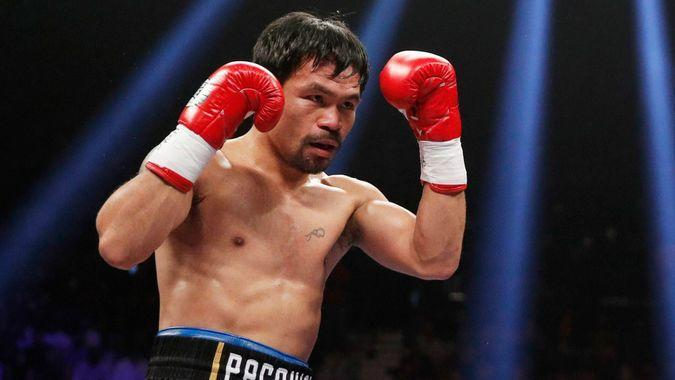 Manny Pacquiao fights Adrien Broner, not pictured, in a welterweight championship boxing match, in Las VegasPacquiao Broner Boxing, Las Vegas, USA - 19 Jan 2019.