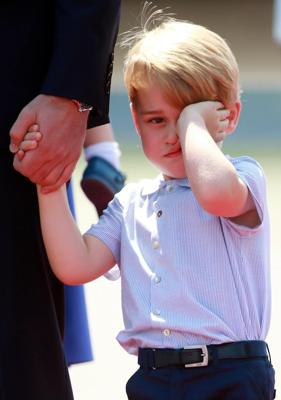 <p><b><b><b>Three-year-old George appeared to be a little tired on arrival.<br><i>[Photo: PA]</i> </b></b></b></p>