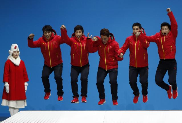 Medals Ceremony - Short Track Speed Skating Events - Pyeongchang 2018 Winter Olympics - Men's 5000m Relay - Medals Plaza - Pyeongchang, South Korea - February 23, 2018 - Silver medalists Wu Dajing, Han Tianyu, Xu Hongzhi and Chen Dequan of China on the podium. REUTERS/Kim Hong-Ji