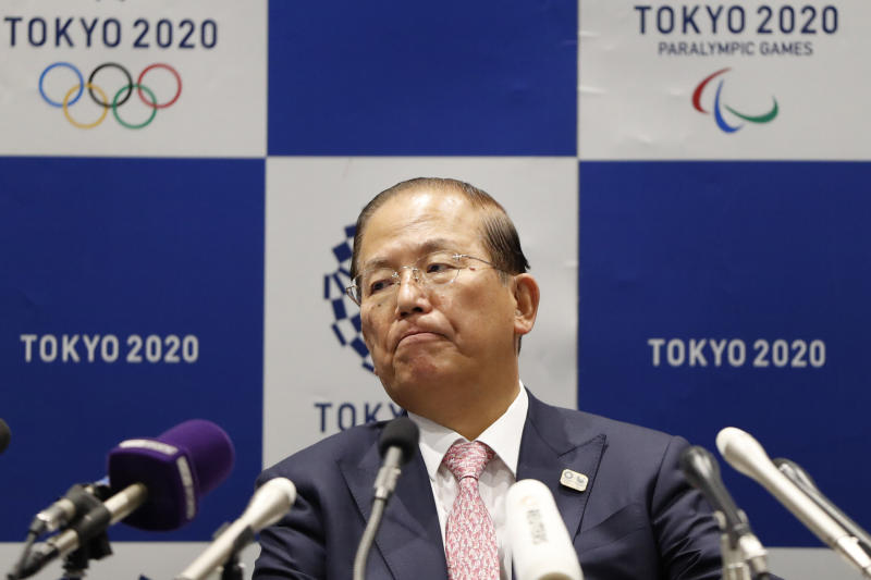 """Tokyo 2020 Organizing Committee CEO Toshiro Muto attends a news conference after a Tokyo 2020 Executive Board Meeting in Tokyo Monday, March 30, 2020. Tokyo Olympic President Yoshiro Mori said Monday he expects to talk with IOC President Thomas Bach this week about potential dates and other details for the rescheduled games next year. Both Mori and Muto said the the cost of rescheduling will be """"massive"""" - local reports suggest several billion dollars - with most of the expenses borne by Japanese taxpayers. (Issei Kato/Pool Photo via AP)"""