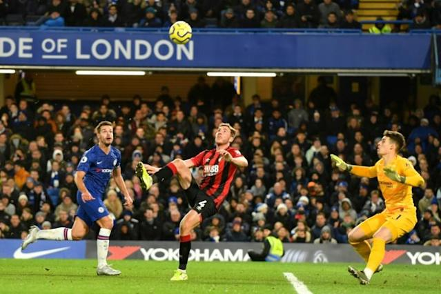 Chelsea dagger: Dan Gosling (centre) loops home the winner over Kepa Arrizabalaga (AFP Photo/OLLY GREENWOOD)