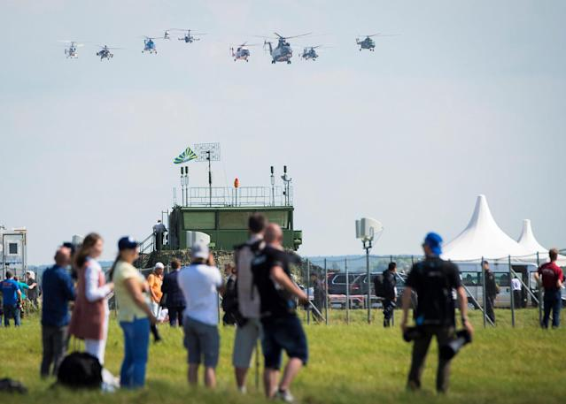 <p>Visitors look at the exhibition flight of Russian helicopters on July 18, 2017 at the annual air show MAKS 2017 in Zhukovsky, some 40 km outside Moscow, Russia. (Photo: Mladen Antonov/AFP/Getty Images) </p>