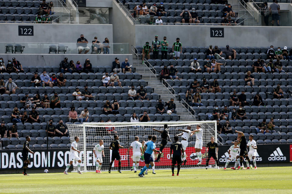 Fans sit in groups of two to four during the first half of an MLS soccer match between Austin FC and Los Angeles FC on Saturday, April 17, 2021, in Los Angeles. (AP Photo/Ringo H.W. Chiu)