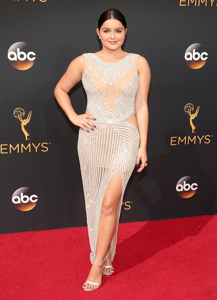 """<p><i>Modern Family</i> star Ariel Winter once again dared to bare on the red carpet, this time at the Emmys in a revealing, diamond-encrusted gown that featured a thigh-high slit and nude panels. Only days ago, <a href=""""https://twitter.com/Cruziiie/status/777635317788450817"""">Kylie Jenner was seen</a> out and about in a shorter version of the same sparkly dress. (Photo by Todd Williamson/Getty Images)</p>"""