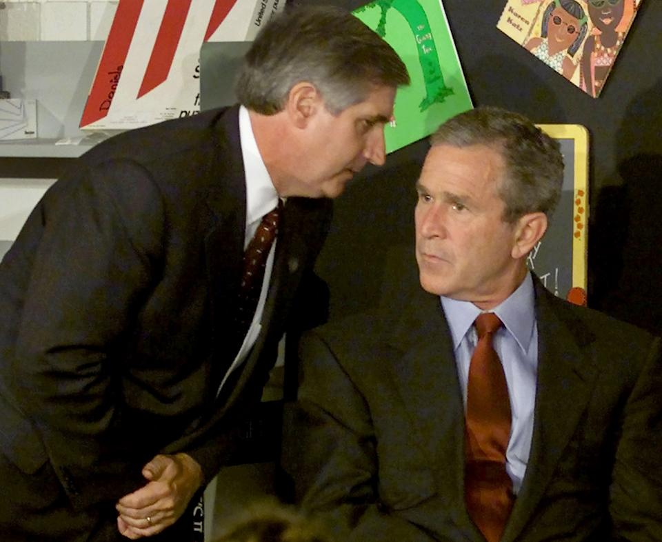 <p>The moment US President George W. Bush listens as White House Chief of Staff Andrew Card informs him of a second plane hitting the World Trade Center while Bush was conducting a reading seminar at an elementary school in Florida. (Reuters)</p>