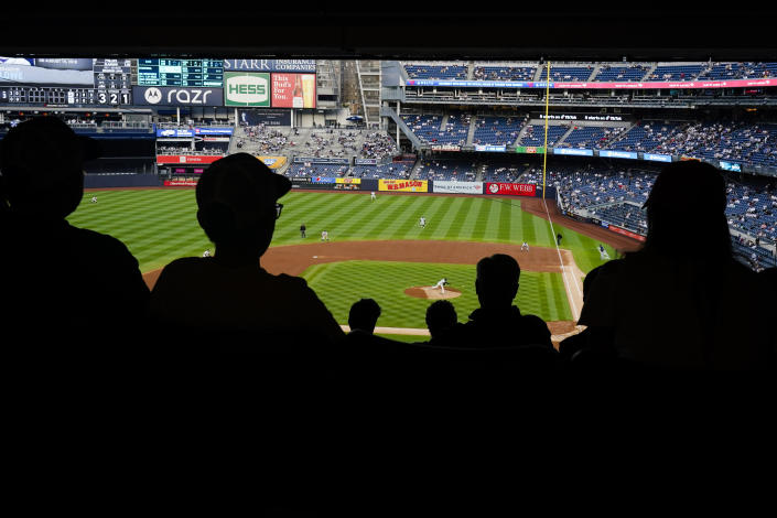 Fans watch during the third inning of a baseball game between the New York Yankees and the Tampa Bay Rays at Yankee Stadium Tuesday, June 1, 2021, in New York. (AP Photo/Frank Franklin II)
