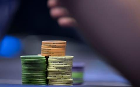"""When 27-year-old accountant Christopher Moneymaker became the first World Series of Poker champion to qualify via an online site in 2003 and claim $2.5million he was the right man in the right place at the right time with the right name. Too good an opportunity to ignore, his surname became immediately appropriated and used to describe the tsunami of popularity in the sport and the numbers of amateur players entering poker events and leaving with the spoils in their bank accounts. """"The Moneymaker Effect"""" will be in evidence this Friday as hundreds of players will travel from all over Europe and pay £420 in the hope of qualifying for the final two days of the prestigious World Poker Tour 'WPT500' and a guaranteed $1 million prize pool at Aspers Casino in London this Easter weekend. As Moneymaker puts it, """"The beautiful thing about poker is that everybody thinks they can play."""" Although this should probably be amended to """"The beautiful thing about poker is that everybody thinks they can play until they enter an event, having played a few hands online and a couple of games whilst drunk in Las Vegas a few years previously."""" Westfield Stratford City in East London is not Las Vegas - even if the people who populate it seem to share the same affection for athleisure wear. It is, however, home to Aspers Casino, a 65,000 square foot gaming space with wall-to-wall slot machines, 55 table and poker games, and, on the weekend I made an impromptu appearance at the 888Live Festival London Main Event in the poker room last October, heaving with humanity and out-there optimism. The gaming floor is, as is the norm, all plush carpet, flashing lights, and a hush of busy concentration occasionally disrupted by the excitement of someone enjoying a temporary upswing in fortunes. It is designed to be exciting and it is. 'There are no white tuxedos here' - the reality of poker Credit: Heathcliff O'Malley/The Telegraph However, if you have never been in a poker room forget any ideas you've """