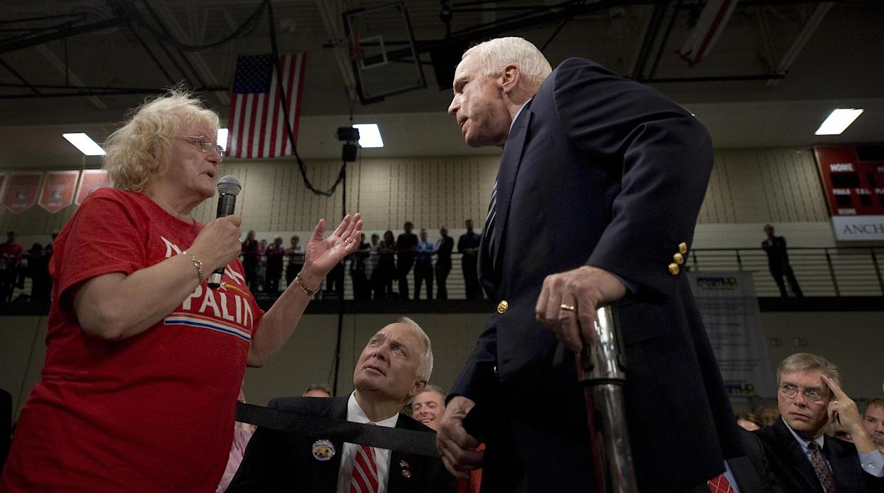 "Sen. John McCain listens to supporter who called Democratic presidential candidate Barack Obama an ""Arab"" during a town hall meeting in Lakeville, Minn., in October 2008. (Photo: Jim Watson/AFP/Getty Images)"