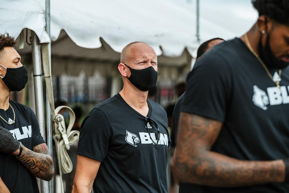 Coach Chris Mack of the Louisville Cardinals men's basketball team joins his players in a protest march on Friday in Louisville, Kentucky. (Photo by Jon Cherry/Getty Images)