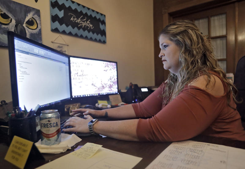 Coral Nichols, vice president and co-founder of Empowered to Change Inc., works in her office Wednesday, Nov. 7, 2018, in Seminole, Fla. Coral is one of around 1.4 million Floridians who stand to get their voting rights back after serving their time for committing a felony. Florida added 1.4 million possible voters to the rolls when it passed Amendment 4, which said most felons will automatically have their voting rights restored when they complete their sentences and probation. (AP Photo/Chris O'Meara)