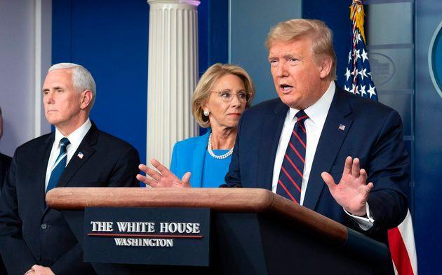 Then-Education Secretary Betsy DeVos stands with President Donald Trump and Vice President Mike Pence during a coronavirus update in March 2020. (Photo: JIM WATSON via Getty Images)